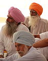 Pilgrims inside the Golden Temple (9693303510).jpg