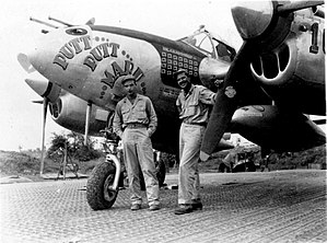 "53d Weapons Evaluation Group - Col. MacDonald and Al Nelson next to his Lockheed P-38L ""Putt Putt Maru(V)"", 44-25471."