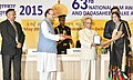 Pranab Mukherjee presenting the Rajat Kamal Award to the Director Paywat, Rep Smt. Nayana Dolas for Best Educational Film, in Non-Feature Film Section, at the 63rd National Film Awards Function, in New Delhi.jpg