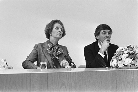 Prime Minister of the United Kingdom Margaret Thatcher and Prime Minister Ruud Lubbers at a press conference in The Hague on 19 September 1983. Premier Thatcher (l) en premier Lubbers tijdens een persconferentie, Bestanddeelnr 932-7047.jpg