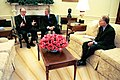 President George W. Bush talks with Federal Reserve Board Chairman Alan Greenspan.jpg