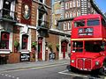 Pub and Heritage Routemaster bus, East London, 15 March 2006.jpg