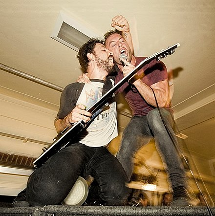 Ben Weinman and Greg Puciato performing in 2011 PuciatoWeinman1.jpg