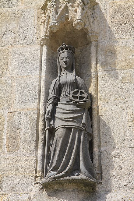 The south porch has this statue of Saint Catherine of Alexandria in a niche in the south buttress. She holds a wheel and a sword. It was on a wheel that she was martyred.