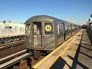 N (New York City Subway service) - An N train of R68 cars at Broadway in Queens.
