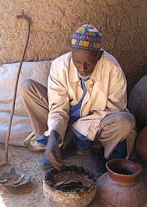Traditional African medicine - A Kapsiki crab sorcerer of Rhumsiki, Extreme North Province, Cameroon uses a form of divination by interpreting the changes in position of various objects as caused by a fresh-water crab.