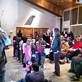 Rocky Creek Elementary 1st grade singing at citizenship ceremony. @uscis (12120003796).jpg