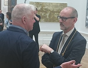 Keith Milow - Keith Milow and Christopher Le Brun at the Royal Academy Summer Exhibition, 2015. In the background Milow's painting First and last