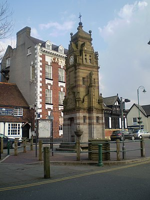 Ruthin - Clock tower on St Peter's Square. In the background are the Myddleton Arms pub, Castle Hotel, and HSBC bank