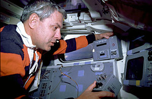 STS-35 - MS Robert Parker manually points ASTRO-1's instruments using a toggle on the aft flight deck.