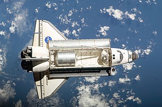 STS-126 - Backdropped by a blue and white Earth, Endeavour prepares to perform the Rendezvous pitch maneuver prior to docking with the International Space Station.