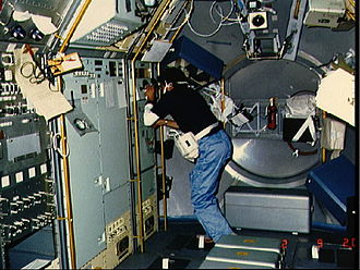 Lodewijk van den Berg - Lodewijk van den Berg observes the crystal growth aboard Spacelab.