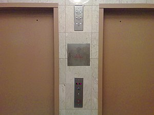 Photo of outside elevator doors and wall colum...