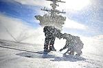 Sailors participate in a flight deck washdown.jpg