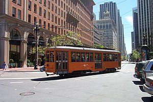 Market Street (San Francisco) - An F Market streetcar turns at the foot of Market Street, in front of the Ferry Building.