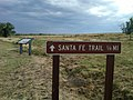 Santa Fe National Trail NTIR sign with wayside in the background at Cimarron National Grassland (2a5c23d1cf5c4002b68301ceef14567e).JPG