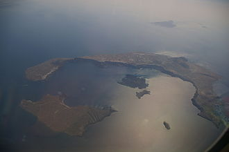 Santorini caldera - Photograph of Santorini caldera from the air.