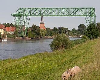 Osten - Osten Transporter Bridge over the Oste  with St. Peter's Church