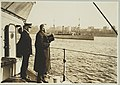 Secretary of the Navy, Josephus Daniels standing on the deck of a ship with the captain reviewing the mine sweeper fleet in the Hudson River LCCN2010651699.jpg
