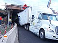 Semi stuck under Interstate 84 on Jordan Road (6147480479).jpg