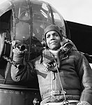 Sergeant Lincoln Orville Lynch DFM, a West Indian air gunner serving with No. 102 Squadron, by the rear turret of his Halifax at RAF Pocklington, February 1944. CH12263.jpg