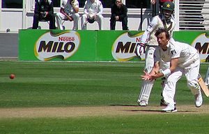 Caught - New Zealand fast bowler Shane Bond about to dismiss Mohammad Yousuf caught and bowled