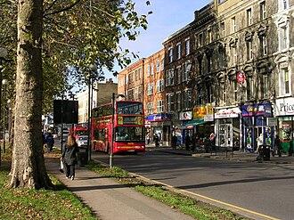 Uxbridge Road - Shops on the Uxbridge Road on the north side of Shepherd's Bush Green