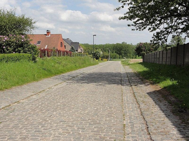 Haaghoek cobblestone road in Sint-Kornelis-Horebeke. Sint-Kornelis-Horebeke, Horebeke, East Flanders, Belgium