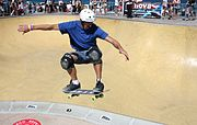 Skate boarder performing a trick.JPG