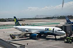 Sky Airlines, A320, Santiago, 27th. Dec. 2010 - Flickr - PhillipC.jpg