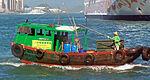 Small green boat in Victoria Harbor, Hong Kong.jpg