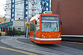 South Lake Union Streetcar Inekon 12-Trio (Orange) at Harrison Street and Fairview Avenue 2010-10-17.jpg