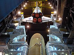 Space Shuttle Discovery lowered toward external tank and solid rocket boosters (STS-124).jpg