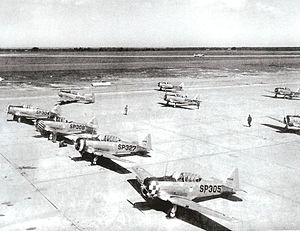 "Spence Air Base - North American AT-6 Texan advanced flight trainers, 1943. ""SP"" was the fuselage code for Spence AAF"