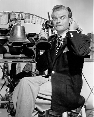 Spike Jones - Jones and some of his musical instruments - empty tin cans - are seen in the background