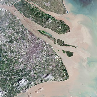 Shanghai - This natural-color satellite image shows the urban area of Shanghai in 2016, along with its major islands of (from northwest to southeast) Chongming, Changxing, Hengsha, and the Jiuduansha shoals off Pudong. Yangtze's natural sediment discharging can be seen.