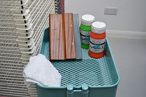Screen printing - Trolley containing a wooden squeegee and acrylic ink