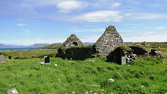 Inishbofin, County Galway - Ruins of a 13th-century church in St. Colman's Cemetery with the mountains of Connemara in the background.