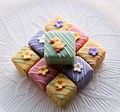 Stacked colourful Easter petits fours.jpg