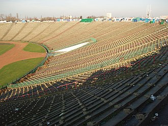 10th-Anniversary Stadium - Terracing of the stadium, with market stalls visible at top.