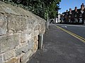 Stone wall and a bench mark in Gladstone Way - geograph.org.uk - 1496941.jpg