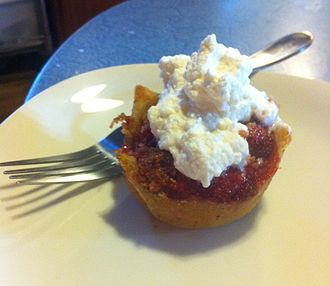 Brown Betty (dessert) - A strawberry Brown Betty with whipped cream