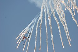 Su-27 Flanker shoots off false heat targets.jpg