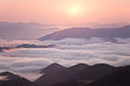 Sunrise over cloudy mountain ridge.jpg