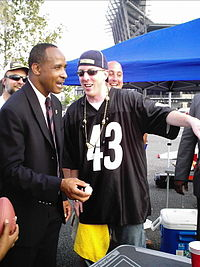 Former Steeler and 2006 candidate for Governor of Pennsylvania Lynn Swann plays beer pong with and courts voters before a football game.