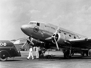 A TWA Douglas DC-3 airplane is prepared for ta...