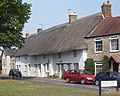 Thatched cottages at The Green, Stanford in the Vale, Oxfordshire.jpg