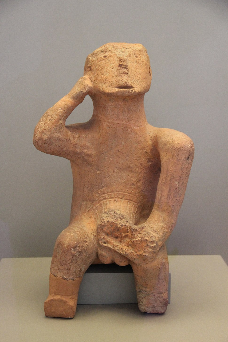 "The ""Thinker."" Large figure of a seated man, Karditsa, Thessaly, 4500-3300 BC"