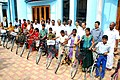 The Minister of State for Agriculture, Consumer Affairs, Food & Public Distribution, Prof. K.V. Thomas presents bicycles sponsored by Public sector Banks to the best students of Njarakkal.jpg