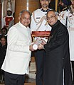 The President, Shri Pranab Mukherjee presenting the Padma Bhushan Award to Dr. Vinod Prakash Sharma, at an Investiture Ceremony-II, at Rashtrapati Bhavan, in New Delhi on April 26, 2014.jpg